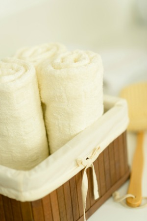 Rolled towels in a basket