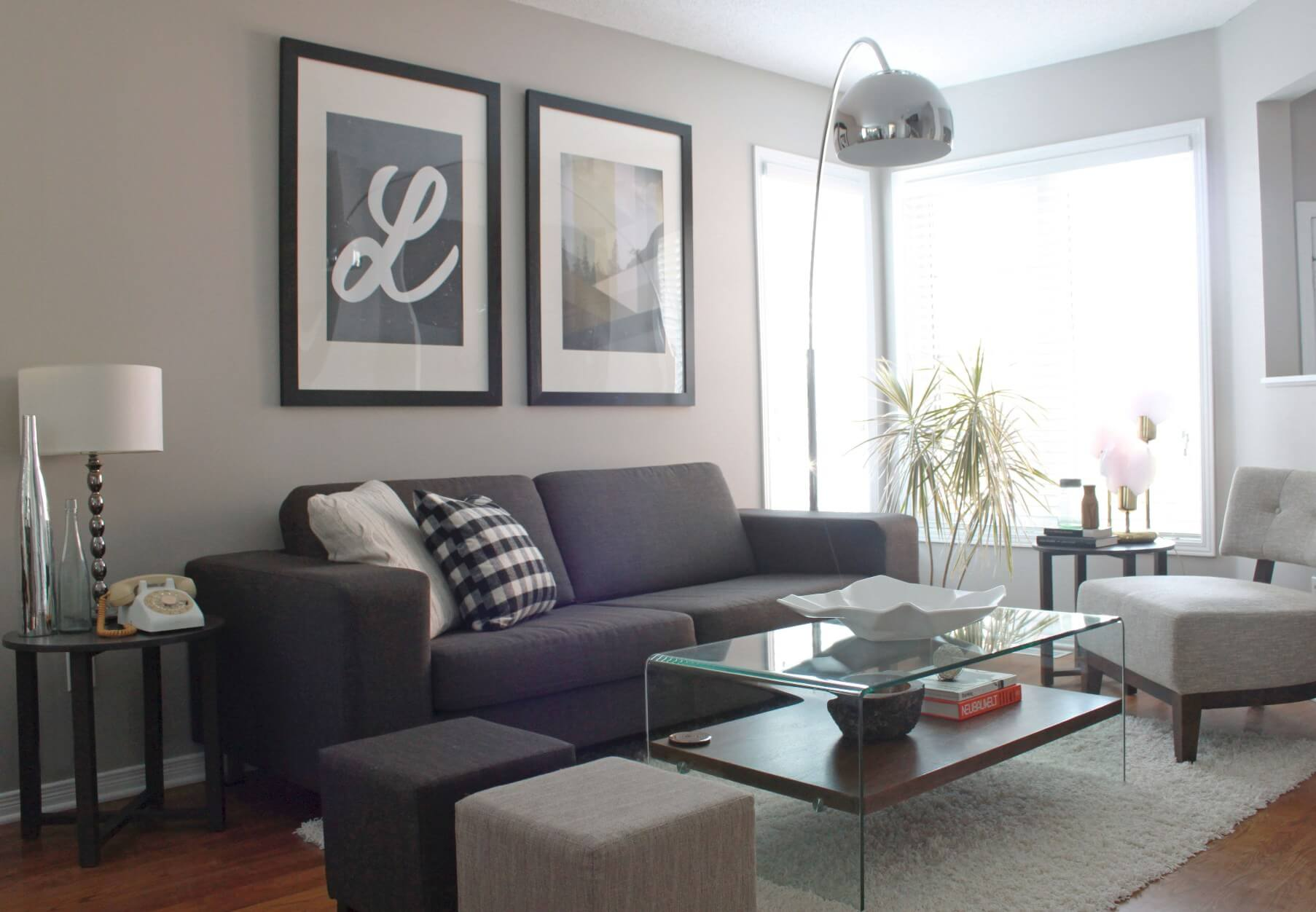A beautifully staged living room in gray tones.
