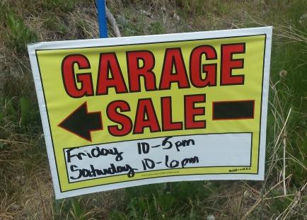 Yellow garage sale sign