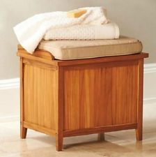 Laundry hamper with seat.