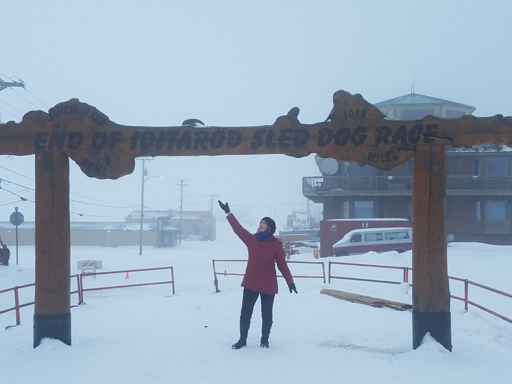 Me standing under the famous burled arch in Nome, Alaska.