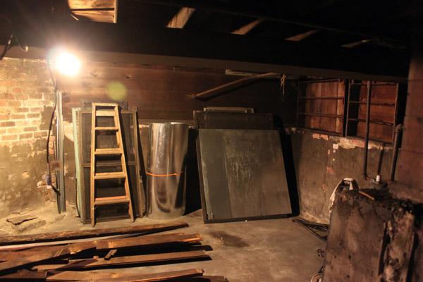 Old dark basement with masonry walls.