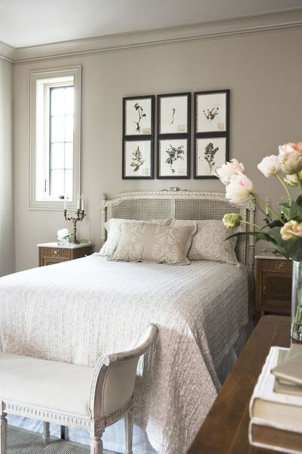 Neutral-colored bedroom with picture collage.