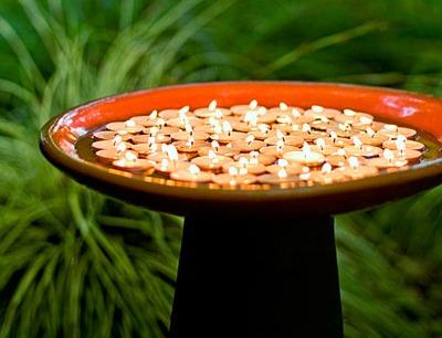 Floating candles in a birdbath