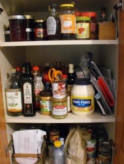 Cluttered pantry cupboard