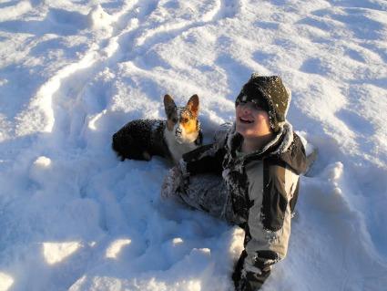 Son and Corgi in the Snow