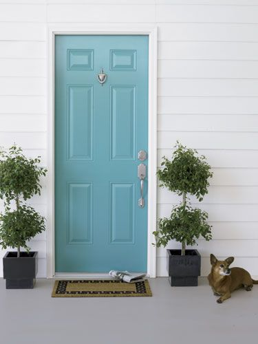 Flank the front door with potted plants.