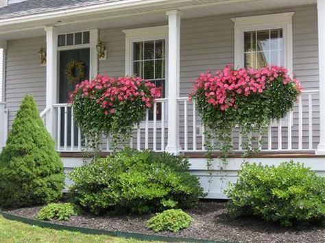 Add porch railing flower boxes to your front entry.