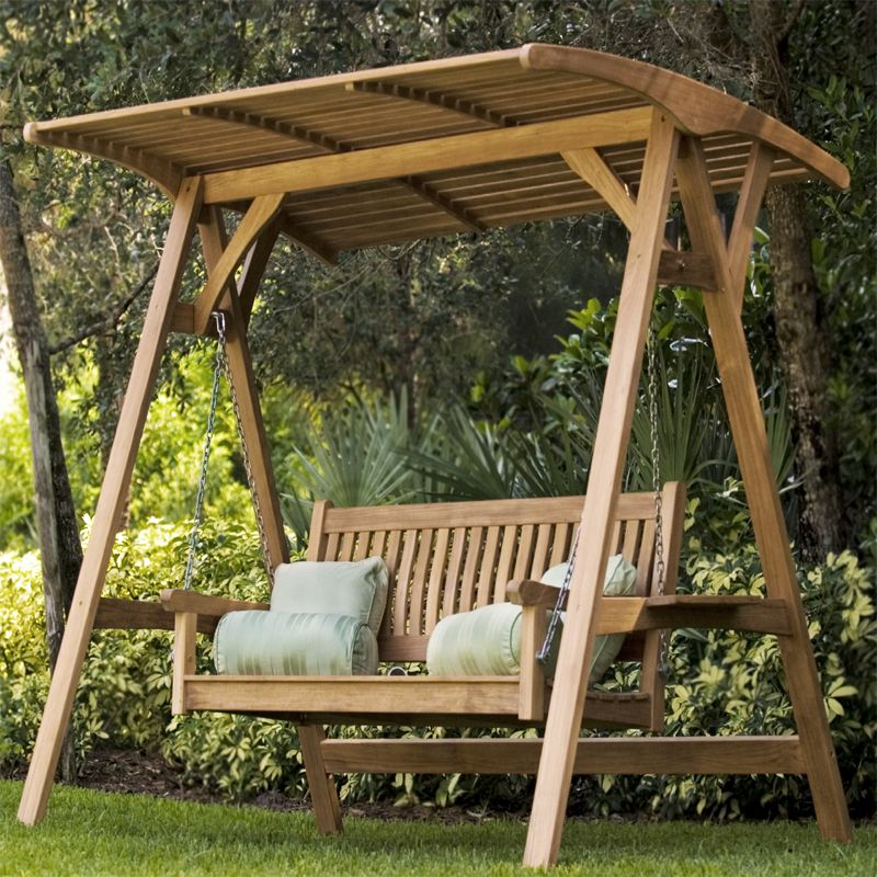 An outdoor covered swing will shelter from the sun and rain.