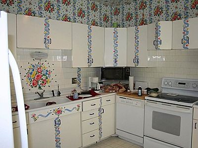 Kitchen with way too much wall paper design.
