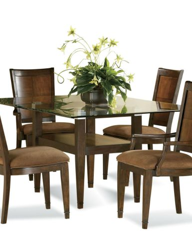Staged dining room table and chairs.