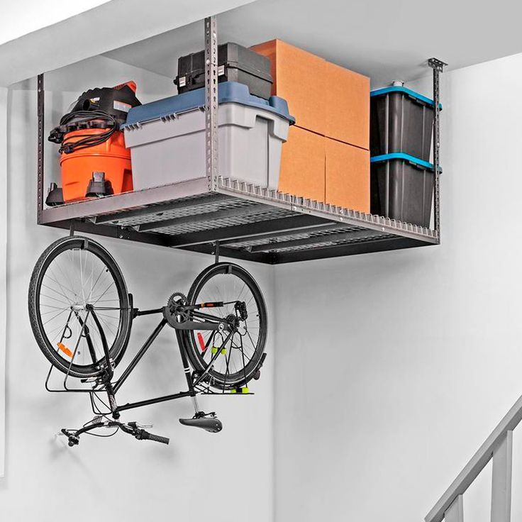 Take advantage of high garage ceilings and install overhead storage.