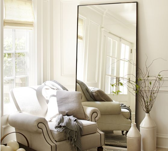 Leaning mirror and chair. How to sell your house.
