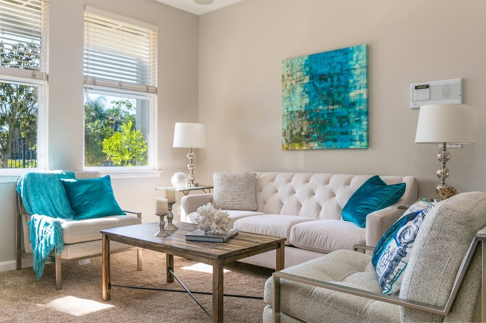 Neutral living room with blue accent colors.