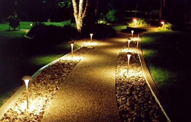 Lead buyers to the front door with night lighting along the walkway.