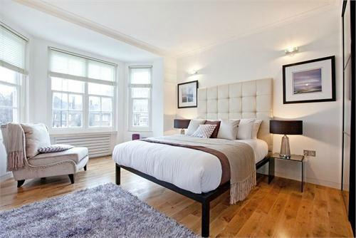 Bedroom with open frame bed