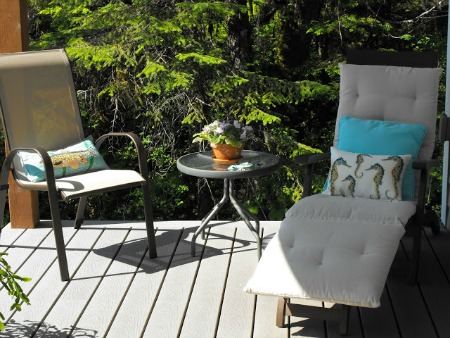 A cozy deck vignette with outdoor furniture