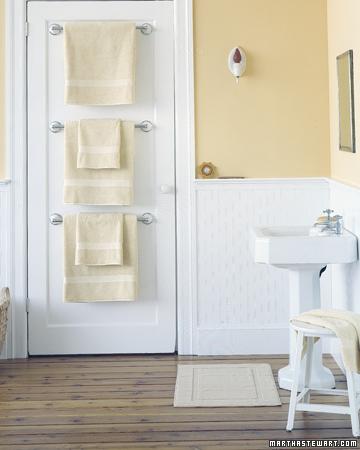 Towels bars behind bathroom door.