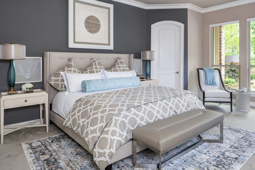 Monochromatic master bedroom with blue accents. Staging the bedroom.