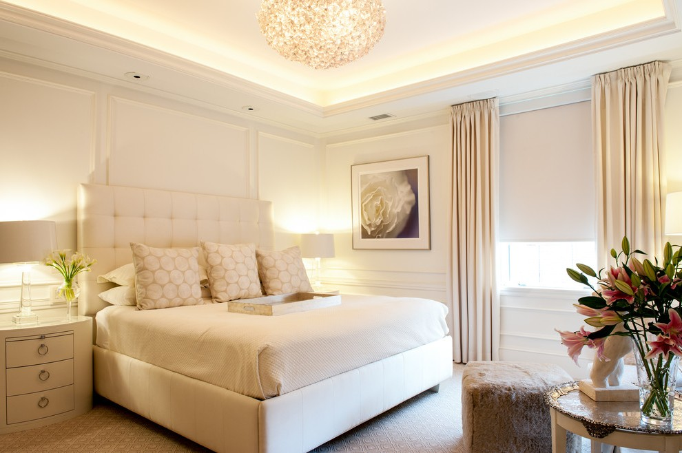 A beautifully stage bedroom in a monotone color scheme.
