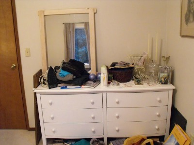 Cluttered bedroom dresser.