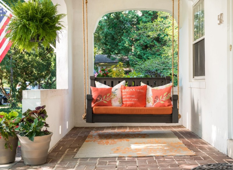 Place a porch swing at the front of the house to increase curb appeal.