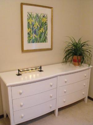 A staged bedroom dresser.