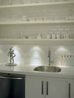 Using an all white collection of objects against a white wall will look less cluttered.