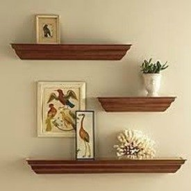 Display decorative objects off center on shelves for a casual look.
