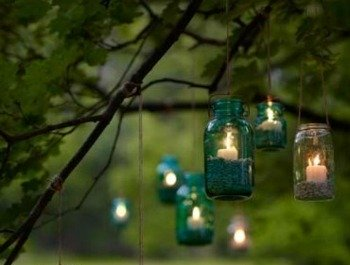 Candles in mason jars for outdoor lighting