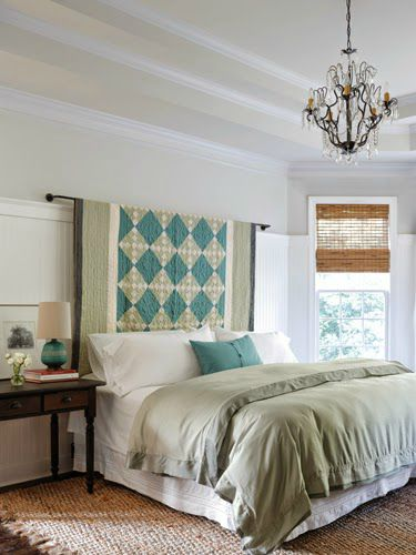 Create a headboard by hanging a beautiful quilt.