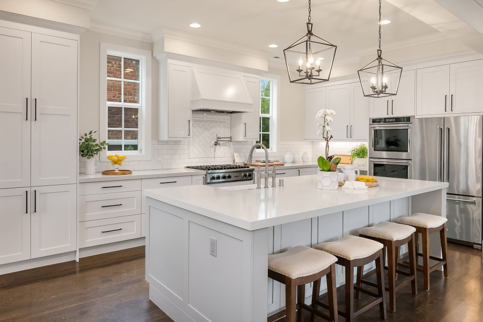 A beautifully staged white kitchen with an island.