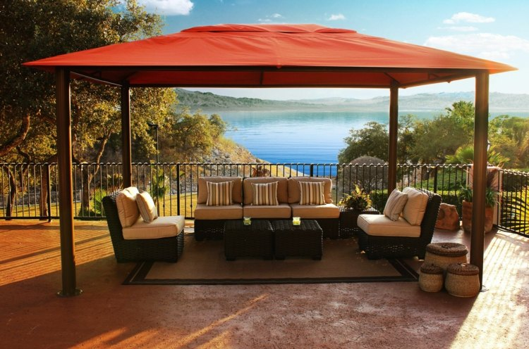 A pergola with canvas roof will shield from sun and rain.