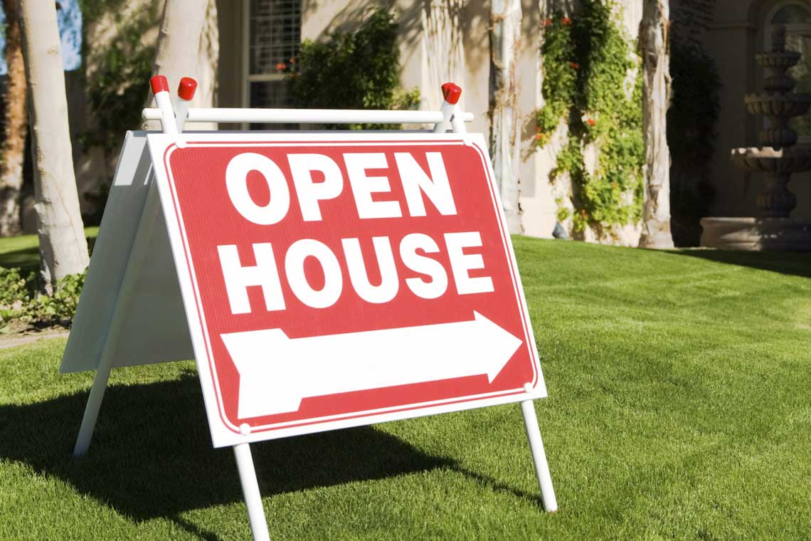 Real estate open house sign.