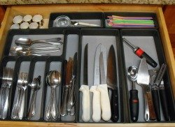 Organized kitchen utensil drawer storage tray.