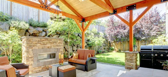 This outdoor entertainment area has it all! A fireplace, barbecue and sitting area.