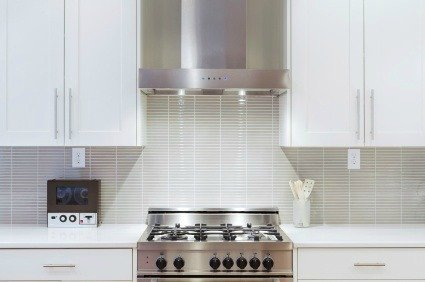 Glass tiled kitchen with range.